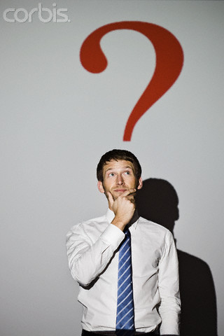 Businessman beneath question mark